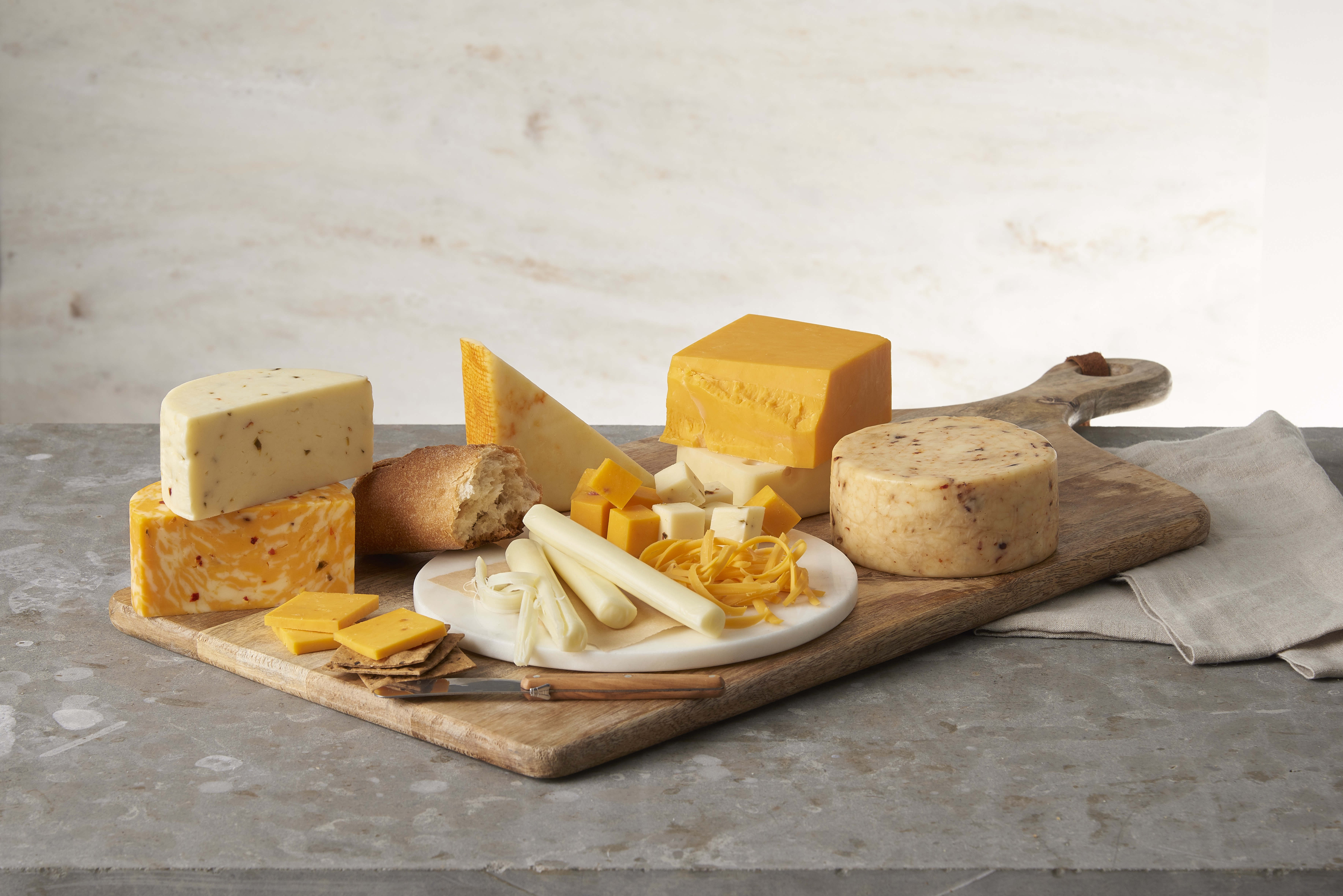 Selection of cheeses on a wooden board